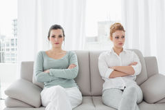 Unhappy friends not talking after argument on the couch Royalty Free Stock Photography