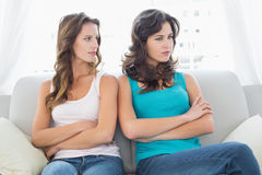 Unhappy friends not talking after argument at home Royalty Free Stock Image
