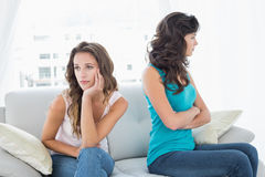 Unhappy friends not talking after argument at home Stock Images