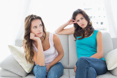 Unhappy friends not talking after argument at home Royalty Free Stock Photography
