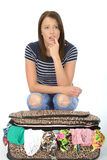 Unhappy Frustrated Attractive Young Woman Sitting on an Overflowing Suitcase Stock Image