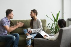 Unhappy frustrated couple discussing relationship problems durin royalty free stock photo