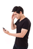 Unhappy, frustrated man with smartphone or cellphone. On white isolated background Stock Photography