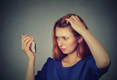 Unhappy frustrated upset woman surprised she is losing hair, receding hairline. Closeup unhappy frustrated upset young woman surprised she is losing hair stock photos
