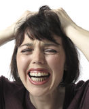 Unhappy frustrated  woman screaming. White background Stock Images