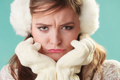 Unhappy funny cute pretty woman girl in earmuffs. stock image