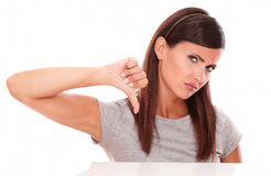 Unhappy girl with bad job gesture Royalty Free Stock Image