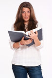 Unhappy girl with book Stock Photography