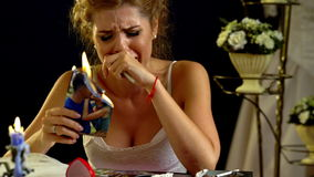 Unhappy girl burn love photos pictures. 4k. stock footage