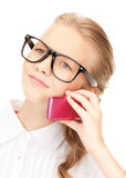 Unhappy girl with cell phone Stock Images