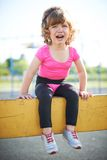 Unhappy girl crying on the playground Stock Photo