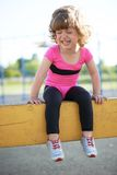 Unhappy girl crying on the playground Royalty Free Stock Photos