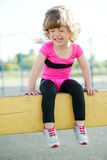 Unhappy girl crying on the playground Royalty Free Stock Photo