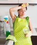 Unhappy girl do housework Royalty Free Stock Photo