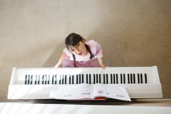 Stressed girl playing piano royalty free stock photos