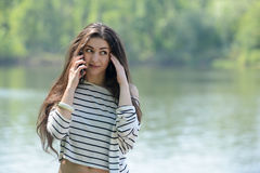 Unhappy girl with mobile phone Stock Photos