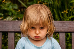 Unhappy girl. Portrait of an angry and upset little girl Royalty Free Stock Photography