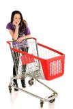 Unhappy girl with shopping cart. Over white background royalty free stock photography