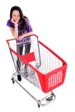 Unhappy girl with shopping cart. Over white background Royalty Free Stock Image
