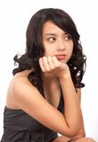 Unhappy girl sitting. With hand on chin Stock Images