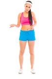 Unhappy girl in sportswear checking body fat. On white Royalty Free Stock Photo