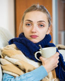 Unhappy girl suffering of quinsy in domestic interior Royalty Free Stock Images