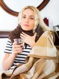 Unhappy girl suffering of sore throat Royalty Free Stock Photos