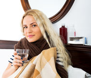 Unhappy girl suffering of sore throat Stock Image