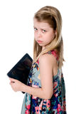 Unhappy girl with tablet computer. Royalty Free Stock Photos