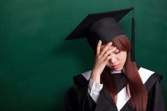 Unhappy graduate student woman Stock Photos