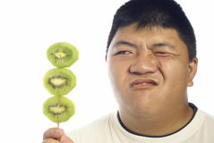 Unhappy with green kiwi fruit Royalty Free Stock Photos