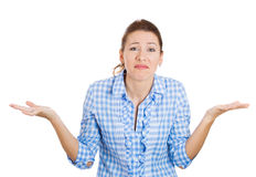 Unhappy grumpy woman showing who cares gesture Royalty Free Stock Photography