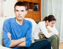 Unhappy  guy against angry woman at home Royalty Free Stock Images