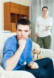 Unhappy guy with aggressive wife Royalty Free Stock Photos