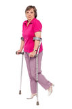 Unhappy handicapped woman with crutches Royalty Free Stock Photo