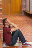 Unhappy handsome student covering his face Stock Image