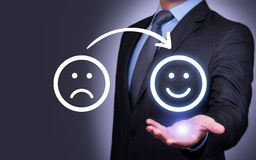 Unhappy and Happy Smileys on Human Hand Royalty Free Stock Photography