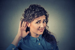 Unhappy Hard Of Hearing Woman Placing Hand On Ear Asking Someone To Speak Up Royalty Free Stock Image