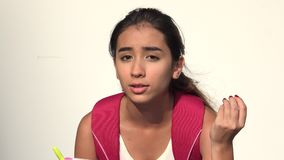 Unhappy Hispanic Female Teen Student Talking. A young female hispanic teen stock footage