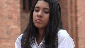 Unhappy Hispanic Girl. A young hispanic female teen Royalty Free Stock Photos