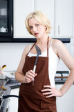 Unhappy housewife Royalty Free Stock Photos