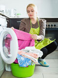 Unhappy housewife with clothes Royalty Free Stock Images