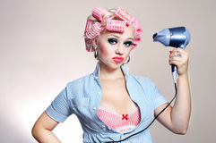 Unhappy housewife with hairdryer Royalty Free Stock Images