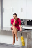 Unhappy housewife in the kitchen Stock Photo