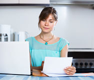 Unhappy housewife reading banking statement Stock Photos