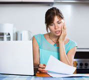 Unhappy housewife reading banking statement Stock Images