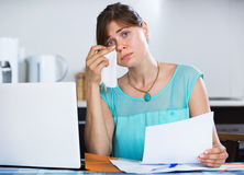 Unhappy housewife reading banking statement Stock Image
