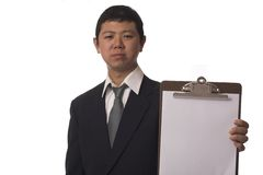 Unhappy inspector. Young asian businessman not to happy about his inspection stock photos