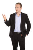 Unhappy isolated blond businessman presenting over white. Royalty Free Stock Photos