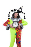 Unhappy joker with clock Stock Image